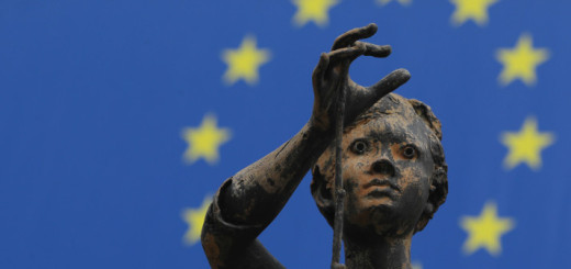 BRUSSELS, BELGIUM - NOVEMBER 17:  One of the  sculptures of young girls by artist Rene Julien stands in front of a flag of the European Union at the Charlemagne building of the European Commission on November 17, 2011 in Brussels, Belgium. Eurozone member countries are continuing to struggle with a debt crisis afflicting a widening circle of nations as the rest of the world fears economic repurcussions.  (Photo by Sean Gallup/Getty Images)