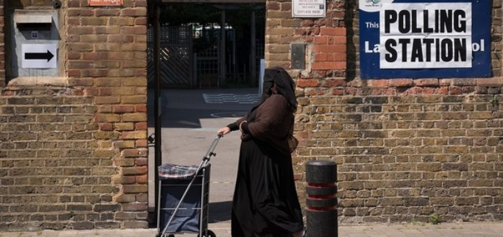 A woman passes a polling station in the Tower Hamlets borough of London on June 11, 2015 as local elections take place. Voters went to the polls to elect a new mayor in the London Borough of Tower Hamlets to replace Lutfur Rahman who was convicted of electoral fraud and removed from office. AFP PHOTO / LEON NEAL / AFP PHOTO / LEON NEAL
